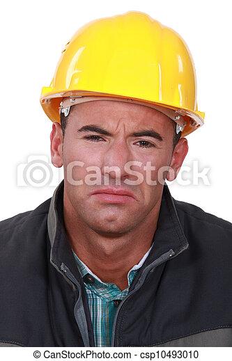 Sad man in a hard hat - csp10493010