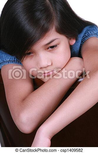 Sad nine year old girl - csp1409582