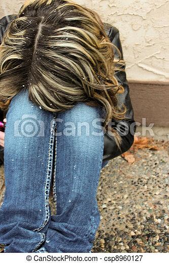 Sad teen with head on knees - csp8960127