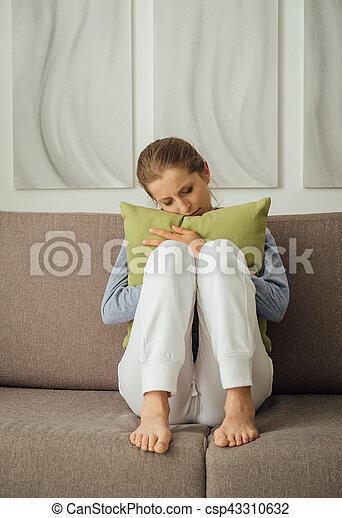 Sad woman hugging a pillow - csp43310632