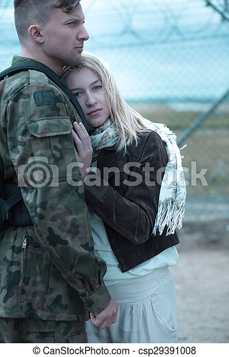 Sad woman hugging military husband - csp29391008