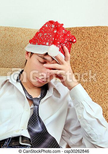 Sad Young Man in Santa Hat - csp30262846