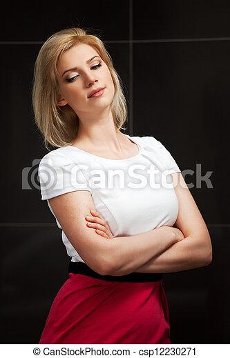 Sad young woman looking down - csp12230271