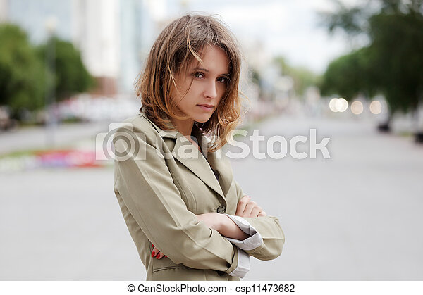 Sad young woman on a city street - csp11473682