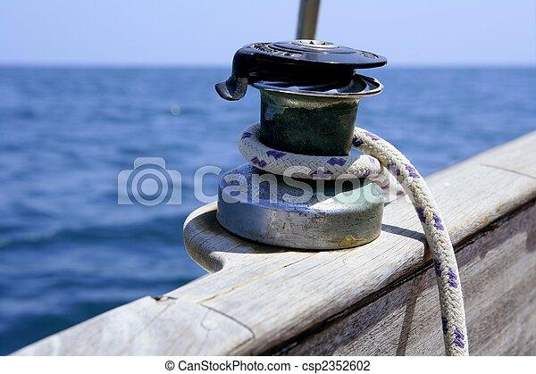 Sail boat winch with marine rope arround - csp2352602
