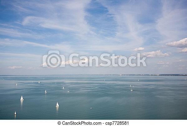 Sail boats on the horizon. - csp7728581