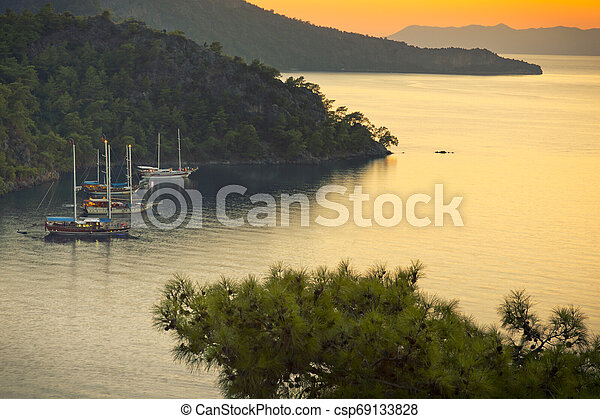 Sailboat in the sea at sunset - csp69133828