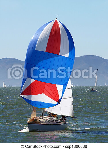 Sailboat running with the wind under spinnaker. Sailboat ...