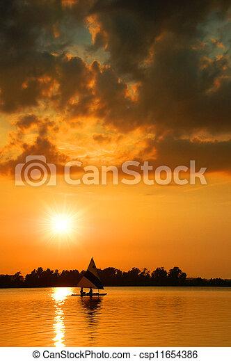 Sailing at Sunset - csp11654386
