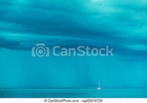 Sailing boat at stormy sea horizon - csp52416729