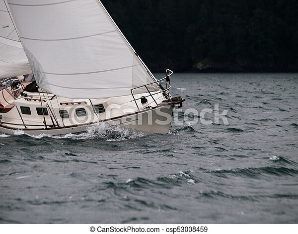 Sailing in a storm - csp53008459