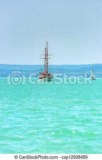 Sailing on beautiful blue sea - csp12938489