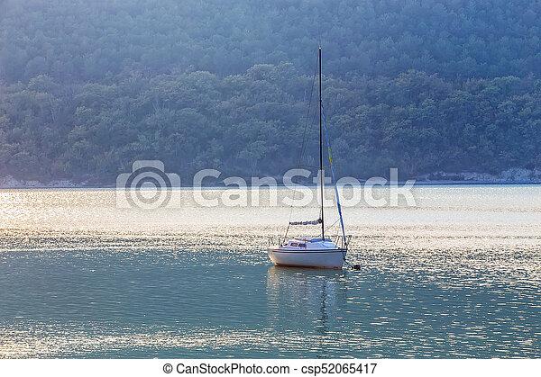 Sailing yacht on beautiful lake - csp52065417