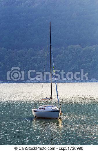Sailing yacht on beautiful lake - csp51738998