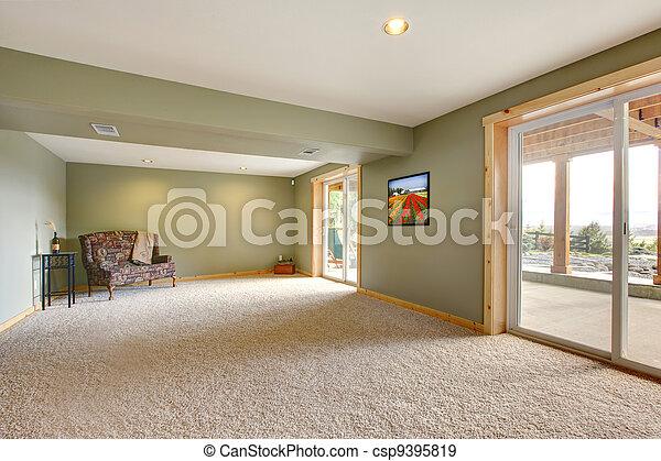 Nivel de tierra, una nueva sala de estar con paredes verdes. - csp9395819