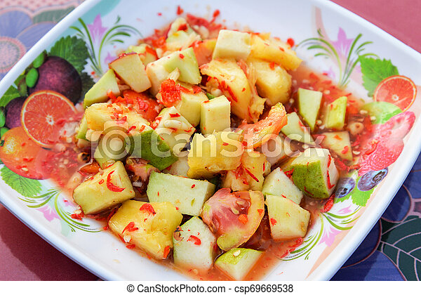 Salad fruit thai style / Slice of fresh fruit mixed with guava tomato pineapple and apple spicy salad - csp69669538