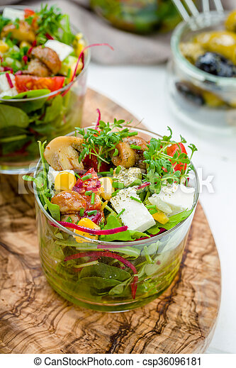 Salad in glass with pickled mushrooms - csp36096181