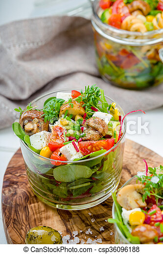 Salad in glass with pickled mushrooms - csp36096188