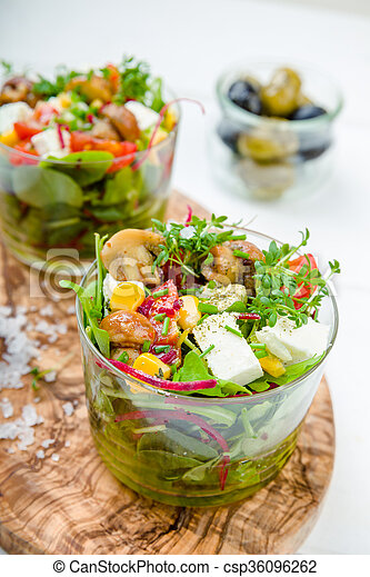 Salad in glass with pickled mushrooms - csp36096262