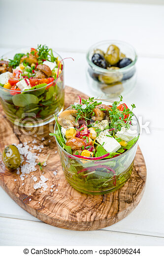 Salad in glass with pickled mushrooms - csp36096244