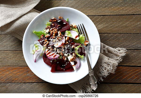 Salad with beetroot and walnuts on a plate - csp26866726