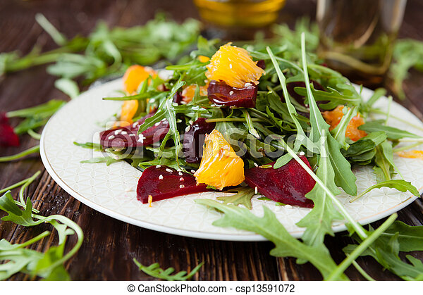 salad with fresh arugula and slices of orange - csp13591072