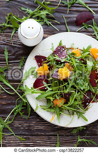salad with fresh greens and beets - csp13822257