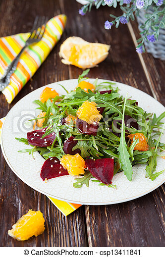 salad with fresh greens, beets and oranges - csp13411841
