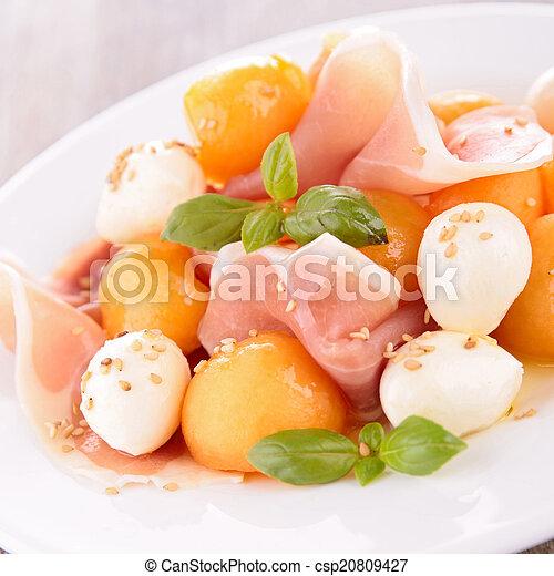 salad with melon, mozzarella and prosciutto - csp20809427