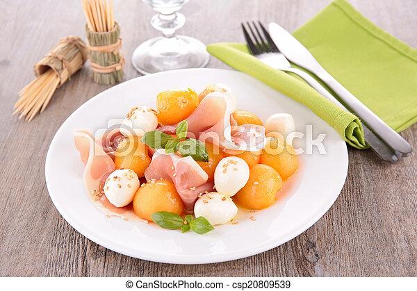 salad with melon, mozzarella and prosciutto - csp20809539