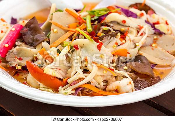 Salad with mushrooms in dish - csp22786807