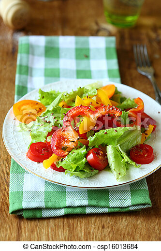 salad with red and yellow peppers and lettuce - csp16013684