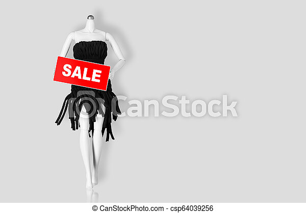 Sale concept. Mannequin holding sale sign isolated on gray background. Copy space - csp64039256