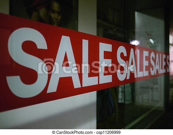 Sale Sign On Glass Window - csp11206999