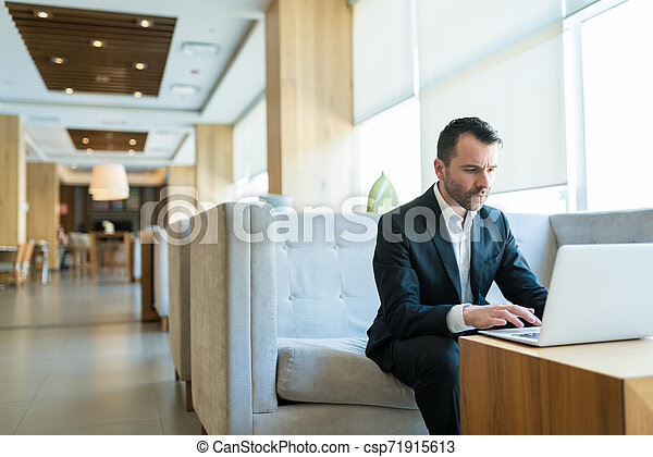 Sales Representative Giving Final Touch For Meeting - csp71915613