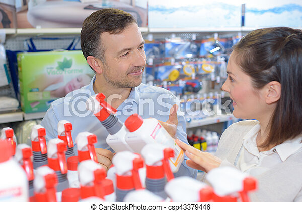 Salesman advising customer in hardware store - csp43379446