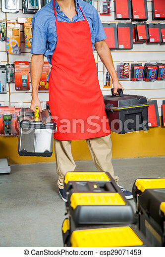 Salesman Carrying Toolboxes In Store - csp29071459