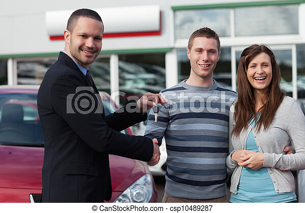 Salesman shaking hand of man - csp10489287