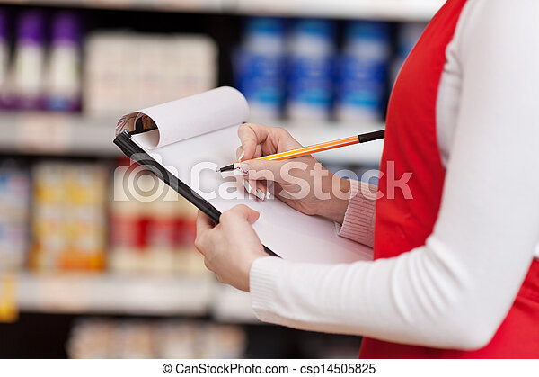 Saleswoman Writing On Clipboard In Grocery Store - csp14505825