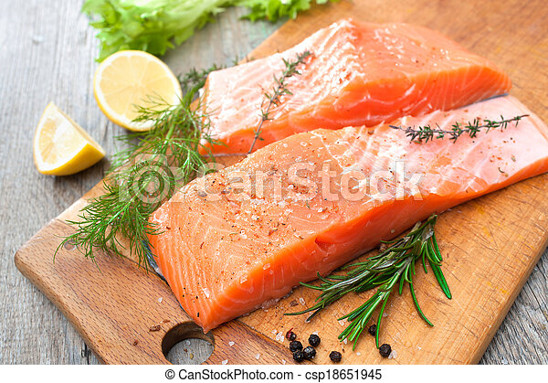 salmon fish fillet with fresh herbs - csp18651945