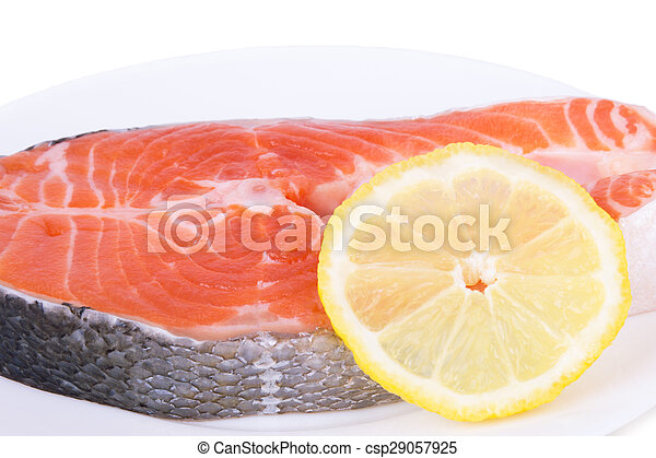 salmon with lemon on a plate - csp29057925