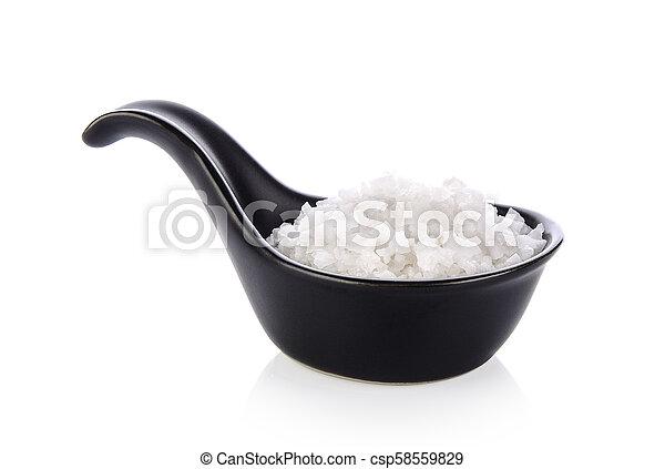 salt in spoon on white background - csp58559829