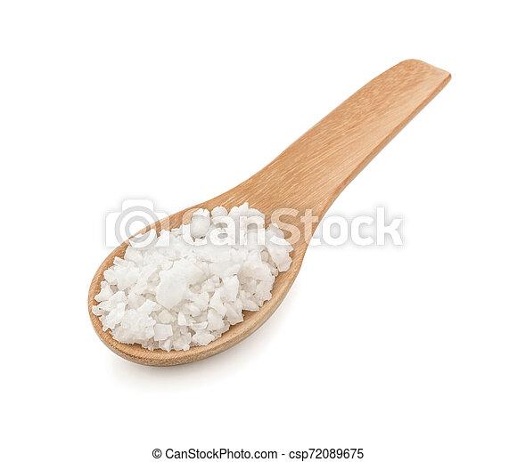 Salt in wooden spoon on white background - csp72089675