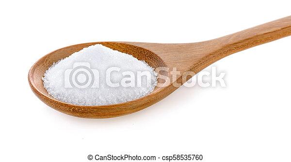 Salt in wooden spoon on white background - csp58535760