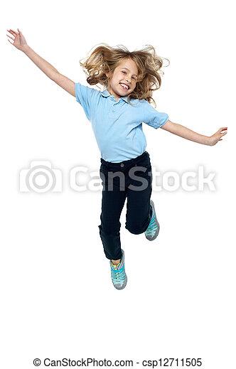 saltando alto, energético, niño joven - csp12711505