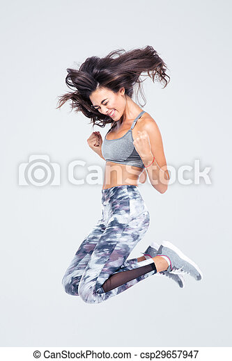 Mujer en forma alegre saltando - csp29657947