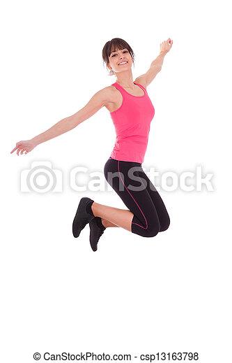 Pésima pérdida, mujer en forma saltando de alegría - csp13163798