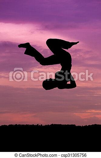 Silueta de mujer saltando - csp31305756