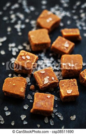 Salted caramel pieces and sea salt close up - csp38511690