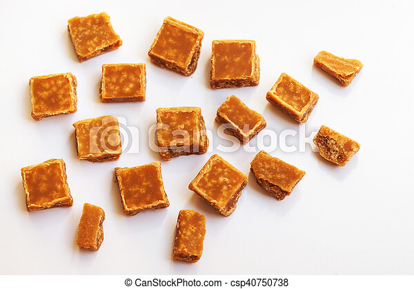 Salted caramel pieces and sea salt. Golden Butterscotch toffee caramels. Toffees. - csp40750738
